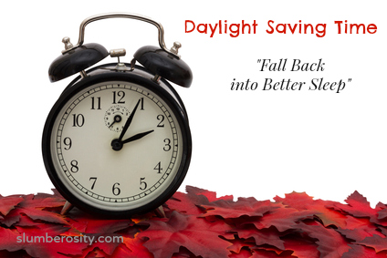 Black Alarm Clock on Red Autumn Leaves isolated on white for copy-space, Autumn Time